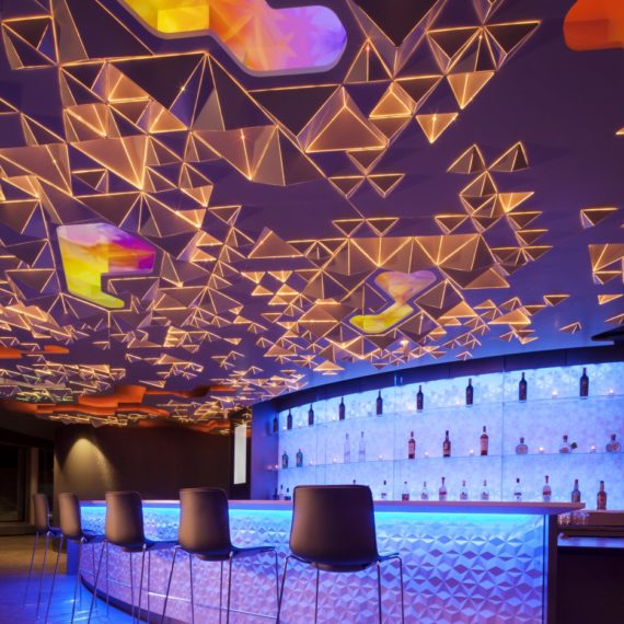 An internal LED system and recessed monitors allowed light and video to become an integral part of the composition, outlining the forms of each pyramid and mimicking the color and depth seen in the Dallas sky.